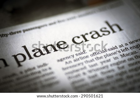 Plane Crash written newspaper; shallow dof; real newspaper. - stock photo
