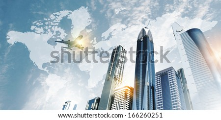 Plane flying above skyscrapers. Business travel concept - stock photo