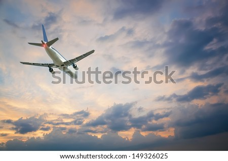 plane flying away against the sky - stock photo