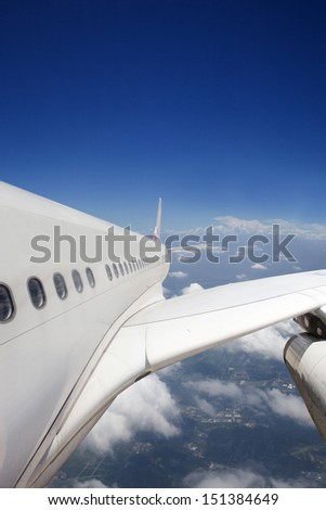plane flying on the background of blue sky - stock photo