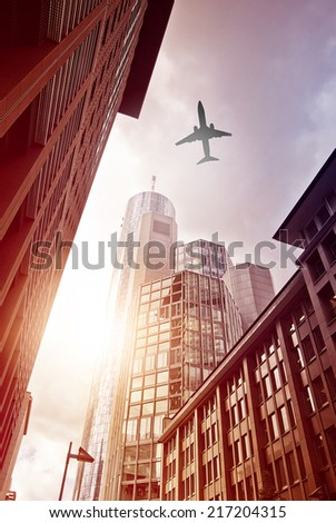 plane flying over office district of Frankfurt am Main, Germany - stock photo