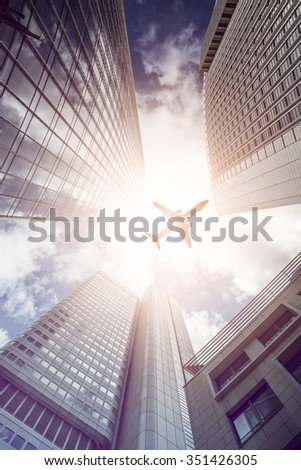 plane flying over office skyscrapers, Frankfurt am Main, Germany - stock photo