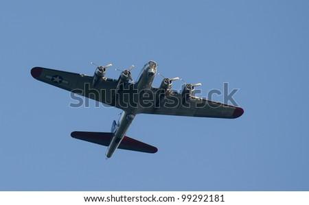plane flying overhead - stock photo