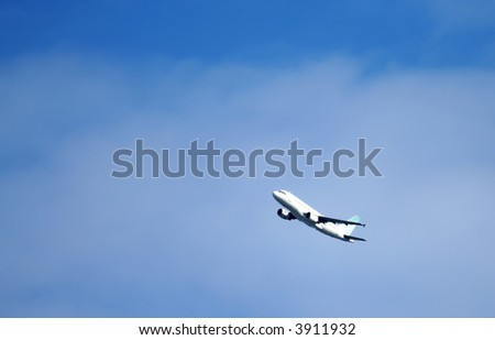 Plane flying overhead with a blue sky background - stock photo