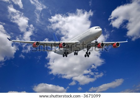 Plane going to land. Blue and cloudy sky. - stock photo