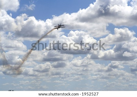 Plane in a aerial show with beautiful sky - stock photo