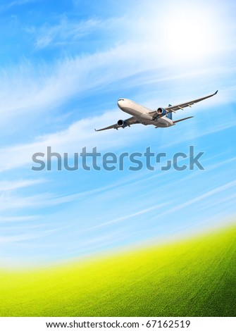 Plane in blue sky - stock photo