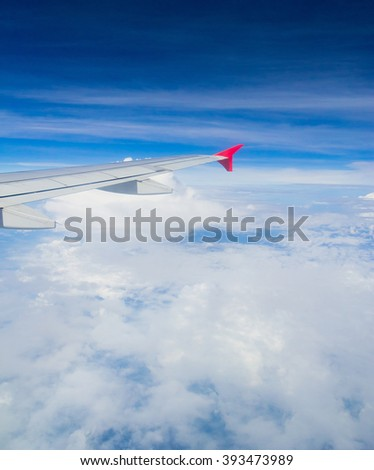 Plane in the Air Skies above and below  - stock photo