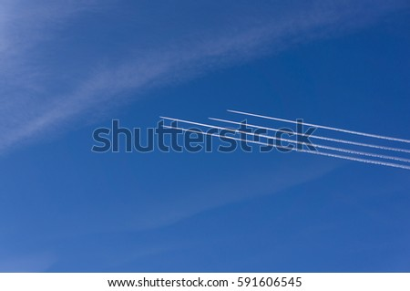 plane in the sky. 4 aircraft in the same direction.