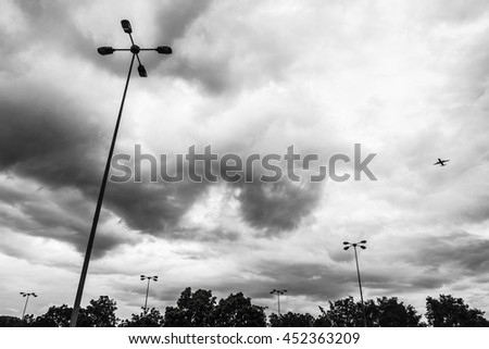 Plane in the sky with monochrome art  - stock photo