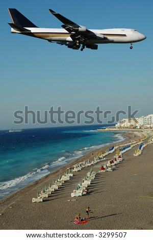 Plane is about to land at an exotic destination - stock photo