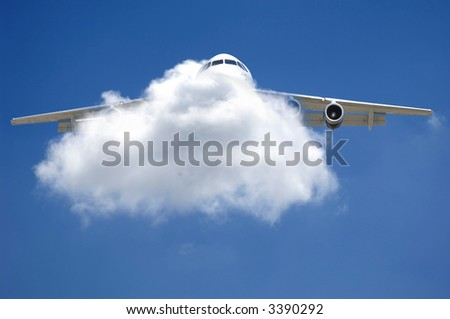 Plane is flying through a cloud. - stock photo