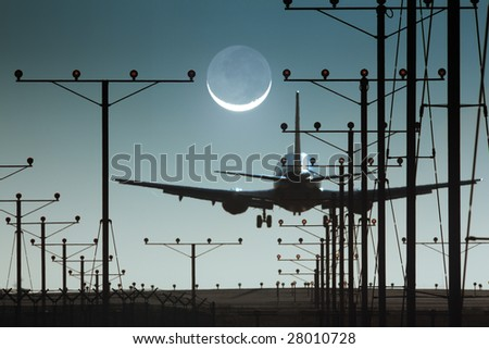 Plane landing or departing in airport at night - stock photo