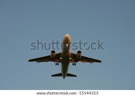 Plane landing with lights on - stock photo