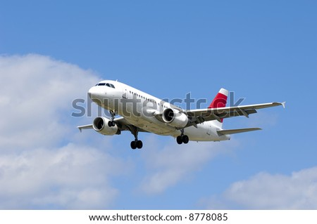Plane on a blue and cloudy sky. - stock photo