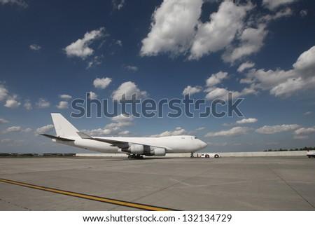 Plane on the apron - stock photo