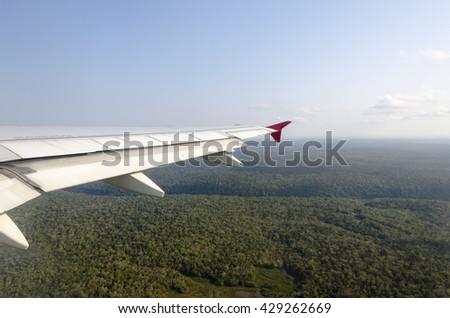 Plane on the runway of Iguacu in Brazil - stock photo