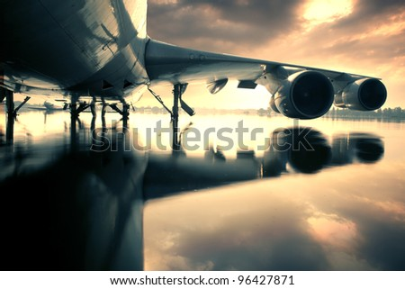 Plane over water in the Thailand flooding at Donmaung International Airport. - stock photo