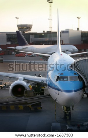 plane parked at the airport - stock photo