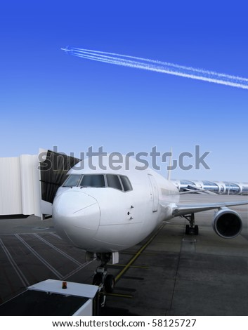 Plane parked together with door embarks, for the next flight - stock photo