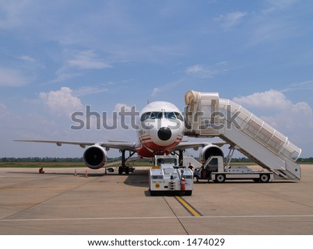 Plane ready for boarding - stock photo