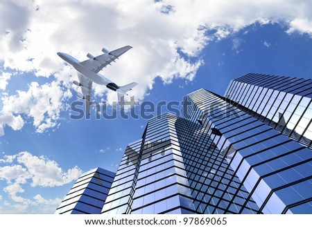 plane reflecting on modern building facade while flying through the sky - stock photo