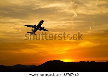 plane ride through the mountains - stock photo