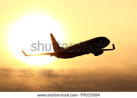 plane silhouette in sunset