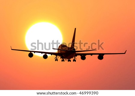 plane take off to sunset - stock photo