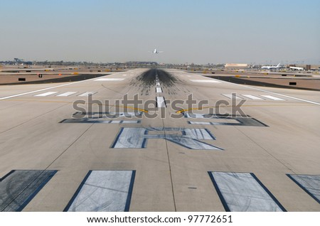 Plane Taking Flight on Runway