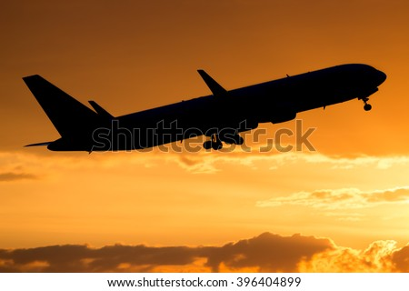 Plane taking off from airport. Plane departing from the airport with sunset sky in the background. Airplane taking off. Sunset sky. Aircraft take off. Wide body airplane flight. Dramatic sky. - stock photo