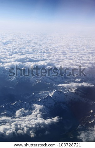 Plane view above the clouds, clean cold nature