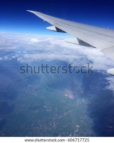 Plane windows view and blue sky lighting & Plane Windows View Blue Sky Lighting Stock Photo 606717725 ... azcodes.com