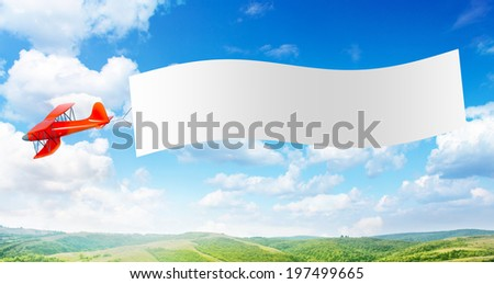 Plane with a banner - stock photo