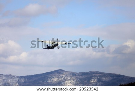 Plane with Sky Divers Aboard takes off from Frozen lake george, NY
