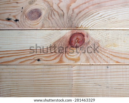 Planed wooden boards surface texture with branches close up for background - stock photo