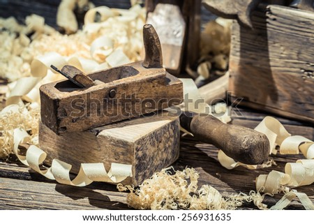 Planer, piece of wood and sawdust - stock photo