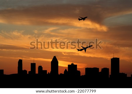 planes departing with Montreal skyline at sunset