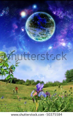 Planet above earth. Fantastic picture - a planet hung over earthly landscape - stock photo