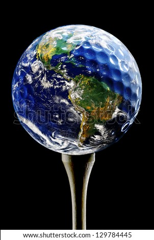 Planet Earth depicted as a Golf Ball on black (original image of planet Earth is a public domain image from NASA) - stock photo