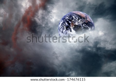 Planet Earth engulfed in a cataclysmic cosmic cloud. Elements of this image furnished by NASA. - stock photo