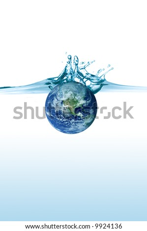 planet earth falling in some blue water - stock photo