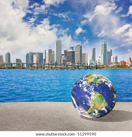 Planet Earth goes on vacation in Miami Florida. Conceptual vacations travel abstract montage - stock photo