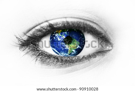 "Planet earth in eye isolated on white - ""Elements of this image furnished by NASA"" - stock photo"