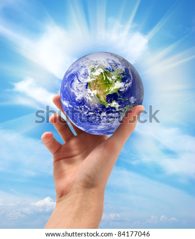 Planet Earth in hand. Conceptual design.