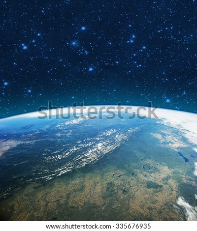 Planet Earth in outer space. Imaginary view of blue glowing earth orbit in a star field.  Abstract cosmos in dark galaxy scientific astronomy background. Elements of this image furnished by NASA.