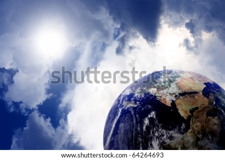 Planet earth in space with sun and clouds