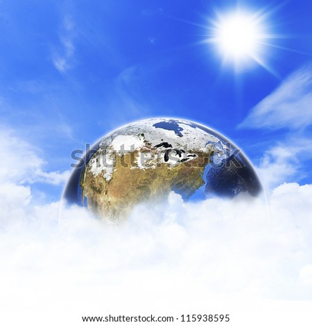 Planet earth in space with sun and clouds. Elements of this image furnished by NASA. - stock photo