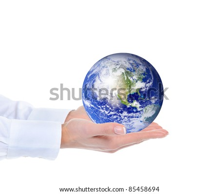 Planet Earth in the female hand. Isolated on white background