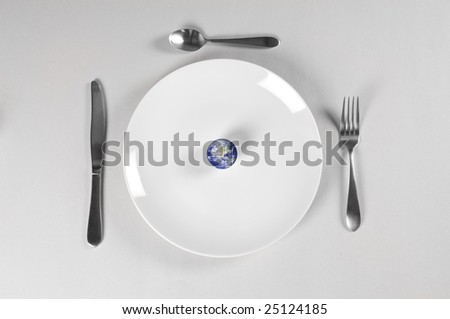 planet earth on a plate for world hunger - stock photo